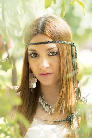 hippie woman: Closeup portrait of beautiful young hippie woman, outdoor. Stock Photo