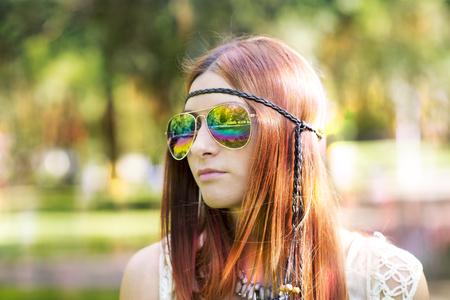 lifestile: Portrait of hippie style woman in summer sunny day, outdoors. Stock Photo