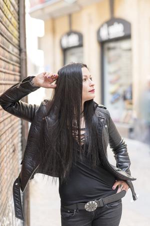 heavy metal: Urban portrait of beautiful woman heavy metal style.
