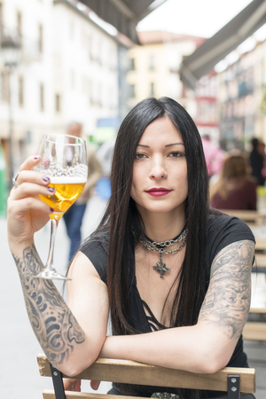 lifestile: Hipster woman with beer. Stock Photo