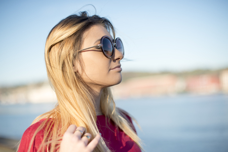 inaccessible: Portrait of the young woman with sunglasses. Stock Photo