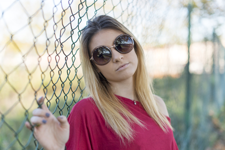 Portrait of the young woman with sunglasses. Reklamní fotografie