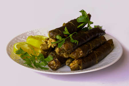 leaf wrap, vine leaf, traditional food, isolated on white, dolmades, sarmale, stuffed, lemon slices, appetizer