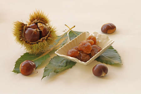 Candied chestnuts and chestnuts on a white background