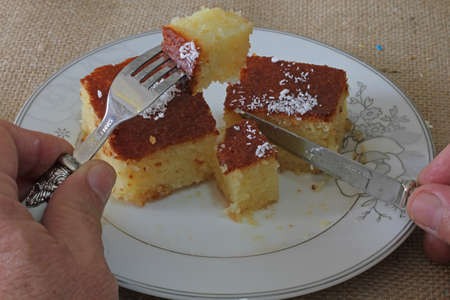 Revani in a white plate, Turkish style revani dessert