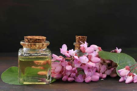 Redbud oil, natural essential oil.