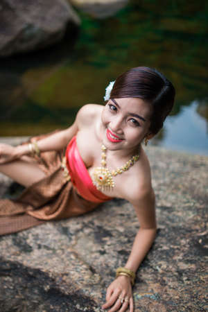 Asian woman wearing dress traditional Thai costume ,beautiful women thai in the past. Stock Photo