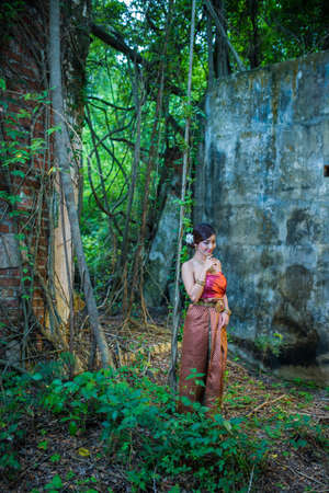 thai dancing: Asian woman wearing dress traditional Thai costume ,beautiful women thai in the past. Stock Photo