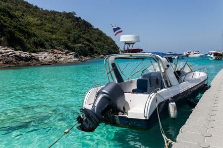 White speed boat anchored at Ra-Cha Marina