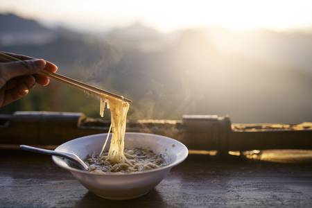 A noodle with landscape of mountain in the morning Stock Photo