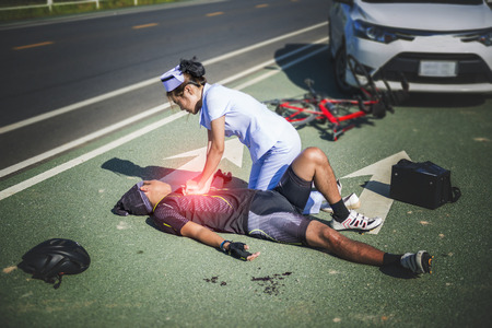 hospital stretcher: Female nurse helping Emergency CRP on bicycle man in an accident