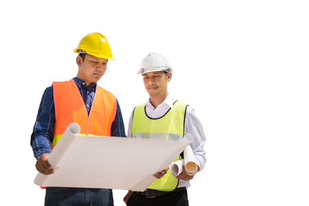 two construction engineer working in construction site on white backgroung, save pahts. Stock Photo