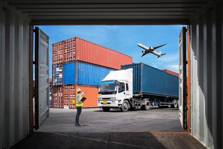 Foreman control loading Containers box to truck for Logistic Import Export Background, Business logistic concept, import and export concept Stock Photo