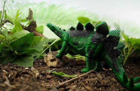 Jungle Dinosaur Green dinosaur stegosaurus standing on nature and leaf background