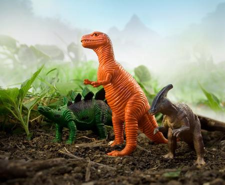 tyrannosaur: Jungle Dinosaur Dinosaurs stegosaurus, tyrannosaur   parasaurolophus standing on nature and leaf background