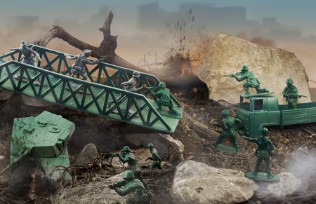green military miniature: Toy battle  Green plastic toy war scene with soldiers, weapons, explosions and fire