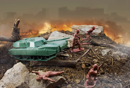 Toy fire battlefield  Plastic toy attack war scene with soldiers, weapons and explosions with fire on background
