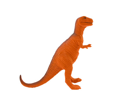 tyrannosaur: Tyrannosaur orange toy. Profile view of isolated orange plastic tyrannosaur standing on white background.