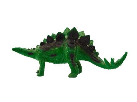 cow teeth: Stegosaurus profile. Isolated plastic green stegosaurus standing back view on white background.