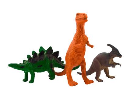 juguetes antiguos: Dinosaurios. Dinosaurios de juguete de plástico aisladas de pie y posando sobre fondo blanco.
