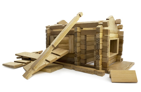 Destructed house. Isolated wooden destructed toy house view. Stockfoto