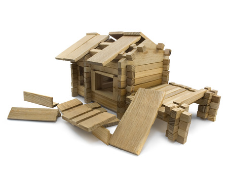 damaged roof: Broken house. Isolated wooden broken toy house view. Stock Photo