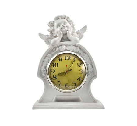 White Cupid clock.Isolated gypsum clock with Cupid laying on the top decoration. photo