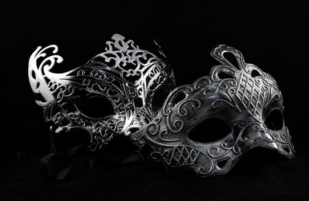 Carnival masks. Holiday carnival masks laying on black background. Banco de Imagens