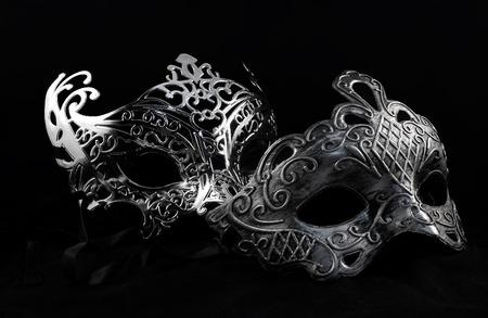 Carnival masks. Holiday carnival masks laying on black background. Banque d'images