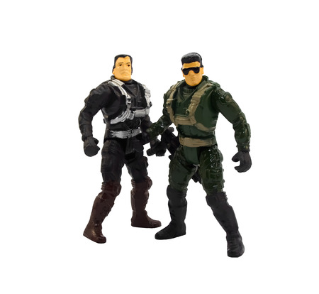 action figure: Toy military soldiers.Two isolated toy plastic soldiers with guns standing.
