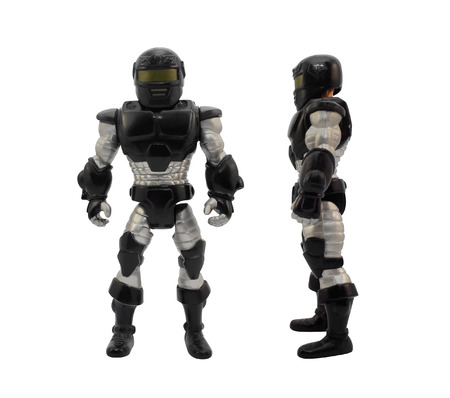 Armored soldier.Isolated armored toy soldier in black futuristic suit standing.