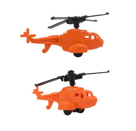 angles: Helicopter toy. Isolated orange helicopter toy in different angles photo.