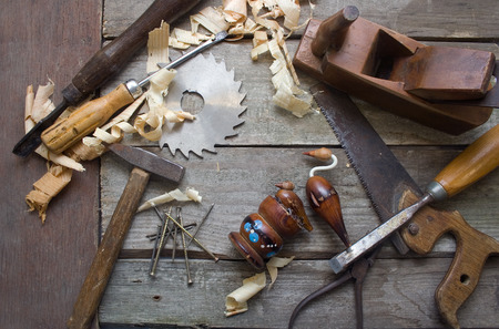 workbench: Rusty hand tools table upper view. Stock Photo
