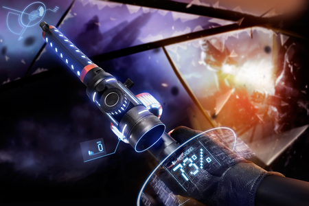 Hand in gloves holding a reloading machine-gun. First person view hand in black leather gloves holding a futuristic neon fantasy reloading automatic machinegun with neon indicators and pointers. Stock Photo