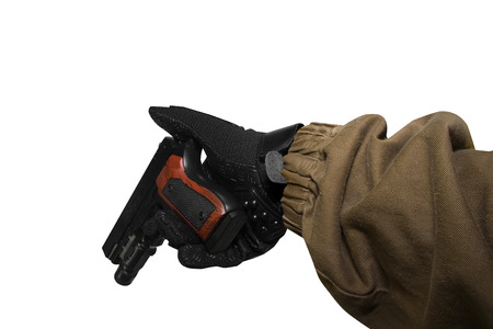 reloaded: Isolated first person view soldier hand in black battle gloves & tactical jacket holding a reloaded gun.