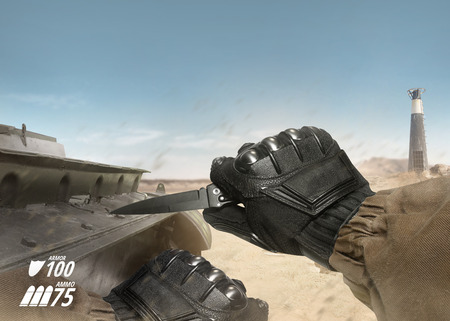 First person view soldier hand in black battle gloves & tactical jacket holding knife ready to use on desert tank war scene with health & armor indicator. Stock Photo