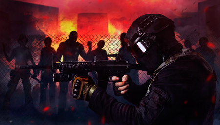 Photo of a swat soldier shooting at attacking zombies on a night burning city background.