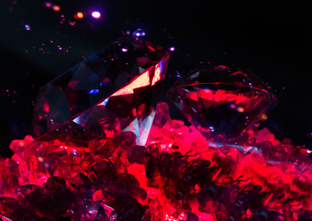 Photo of a rich glowing diamonds laying on a red lightened quartz stones with bright sparkles effect on background.