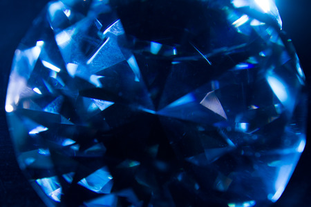 Macro photo of a blue ice cold shining diamond closeup texture. Stockfoto