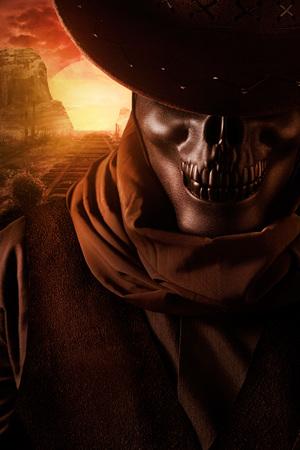 Skeleton ghost cowboy  in black hat closeup portrait view  on desert rails sunset background. Zdjęcie Seryjne