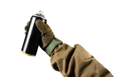 First person view military hand in tactical jacket and gloves holding paint spray can. Stock fotó