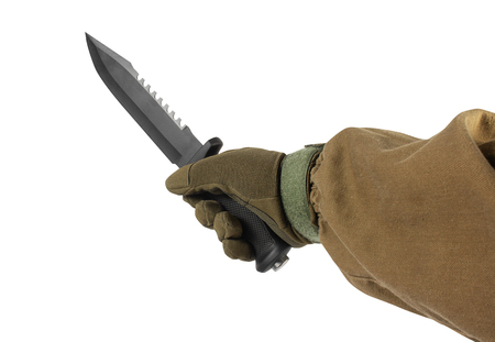 Isolated photo of a first person view arm in tactical jacket and gloves holding black military and hunting knife on white background.
