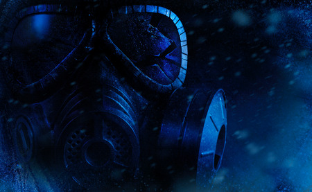 Photo of a broken glass military black gas mask laying frozen on black background with falling snow.