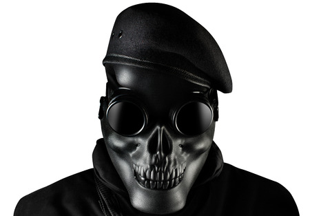 Photo of a fully equipped soldier in black armor vest standing in skull mask, glasses and beret isolated on white background closeup front view. Stock Photo