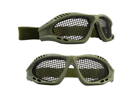 Isolated photo of green tactical military and strikeball glasses on white background.