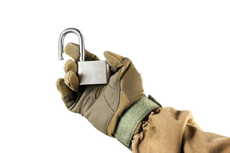 Isolated photo of a first person view arm in tactical jacket and gloves holding opened steel lock on white background.