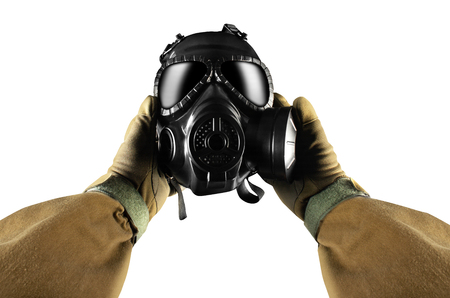 Isolated first person view military hands in tactical gloves holding gas mask on white background.