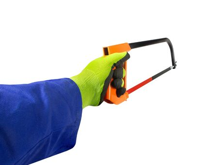 Isolated photo of a worker hand in gloves holding hacksaw, first person view on white background. Banco de Imagens