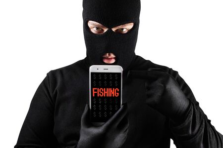 Photo of a male thief in mask and gloves holding smartphone with fishing message on it.