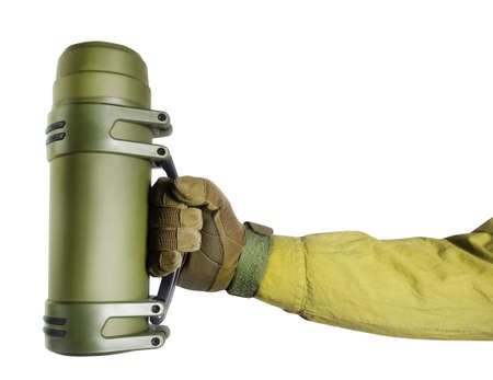Isolated photo of soldier  hand in glove holding tactical flask on white background. Stockfoto
